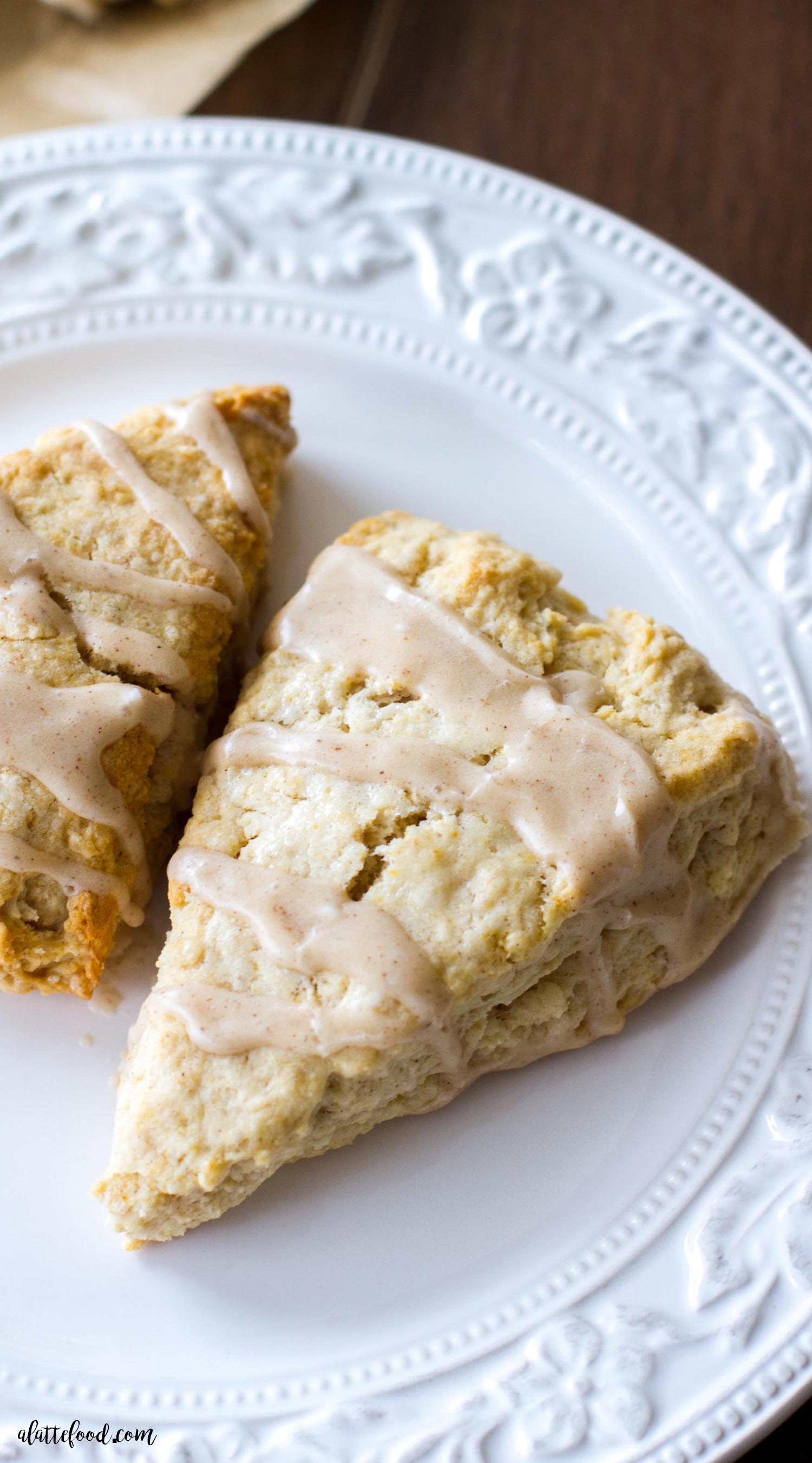 These light and flaky Maple Cream Scones are full of sweet maple flavor and topped with a cinnamon spice glaze! These Maple Cream Scones are the perfect fall breakfast, or sweet fall dessert! how to make scones, maple scones, homemade scone recipe